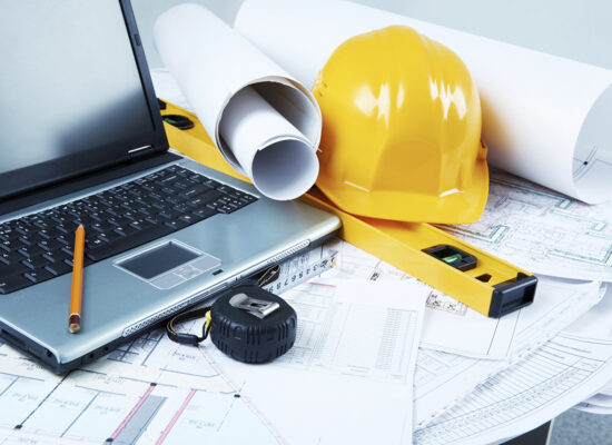 Image of laptop, architectural tools and blueprints